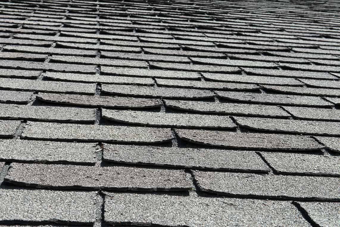 Old Bad Curling Roof Shingles